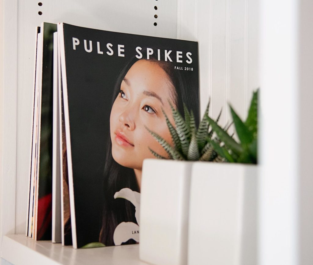 Past issues of Pulse Spikes on a bookshelf